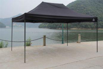 a huge canopy beside a lake