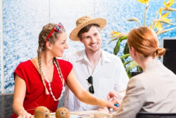 a couple talking to a travel agent
