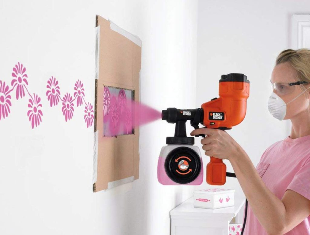 designing a wall with a paint sprayer