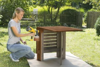 spraying a furniture with paint