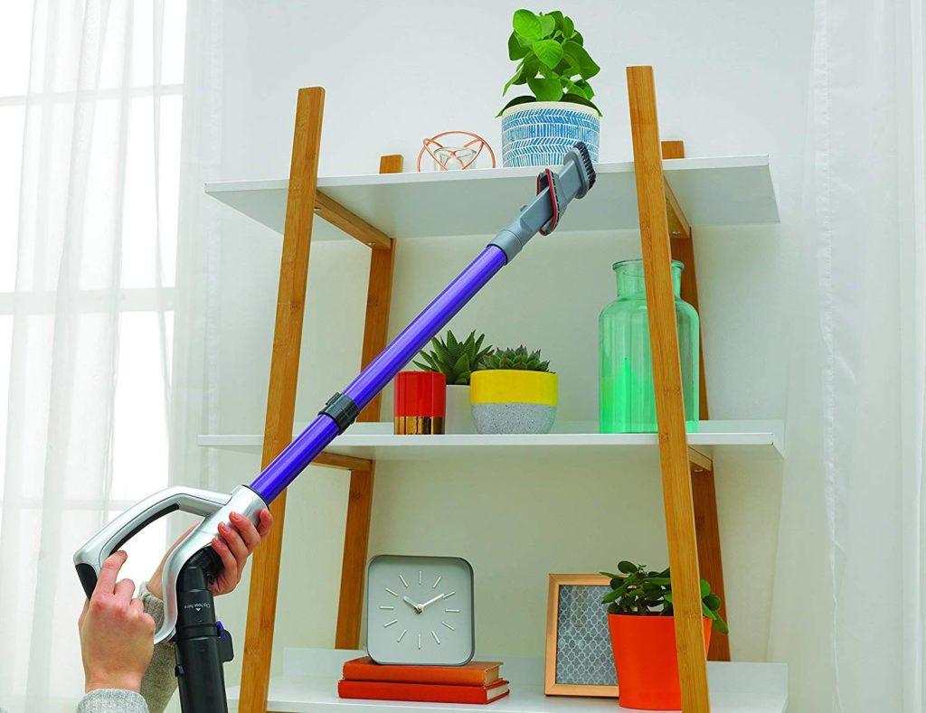 vacuuming a shelf
