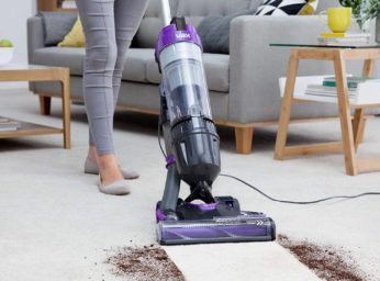 vacuuming dirt on a carpeted floor