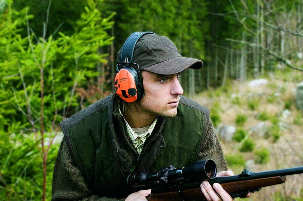 a hunter wearing ear muffs