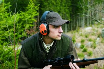 a hunter wearing ear muffs