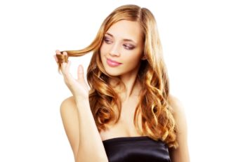 a lady twirling her hair