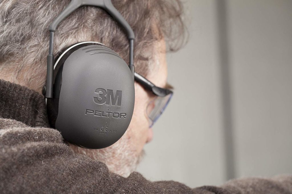 close up of a man with ear defenders
