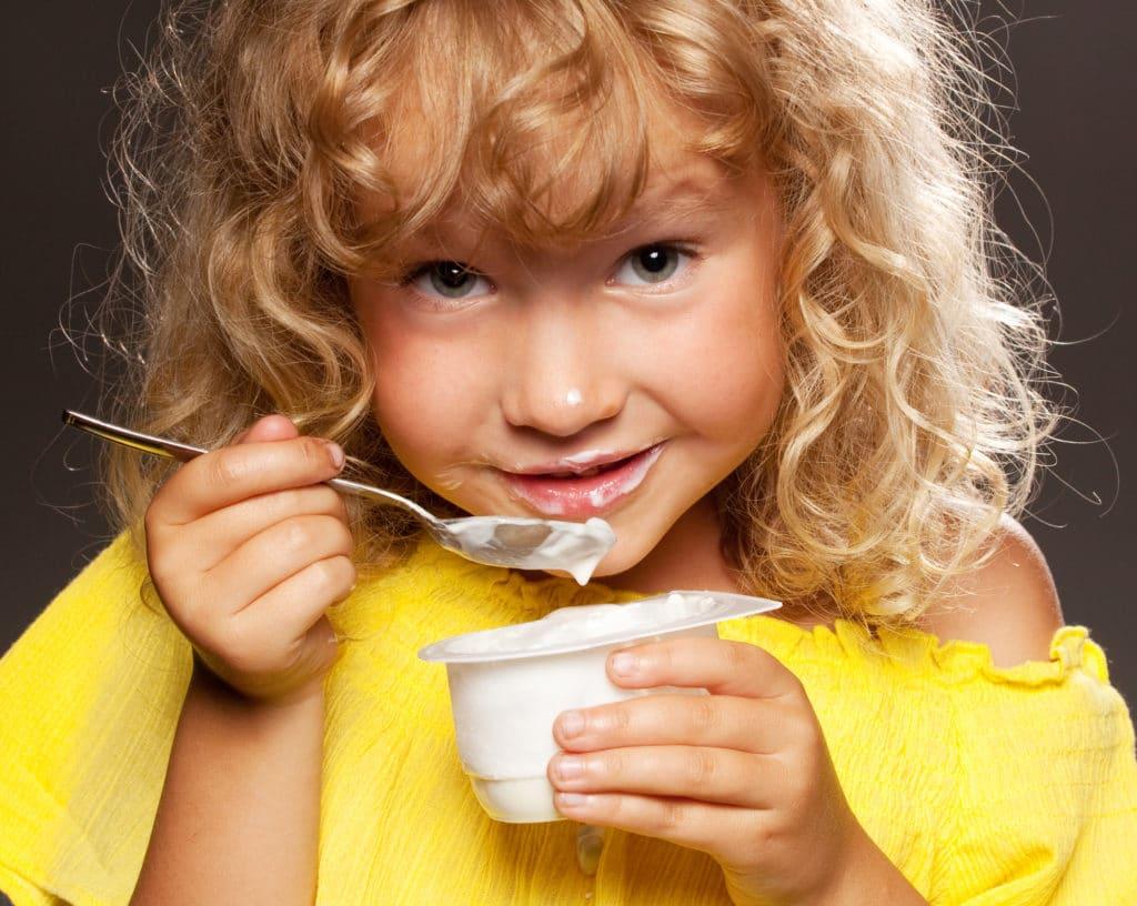 a child enjoying a snack