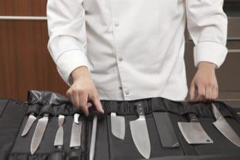 chef choosing blade sharpener from set
