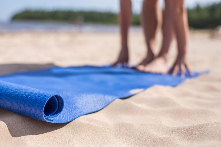 yoga mat on sandy beach