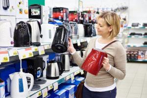Woman housewife shopping for kitchen appliances