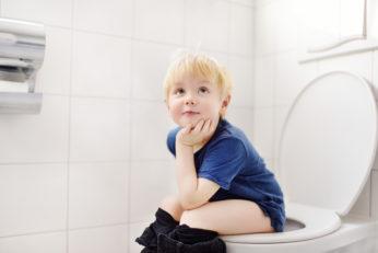 a cute little boy in a restroom