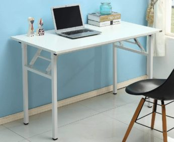 a white computer table with a laptop and books on top