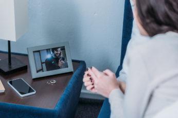 a woman looking at a photograph