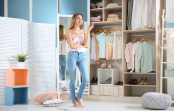 a woman standing infront of a huge closet
