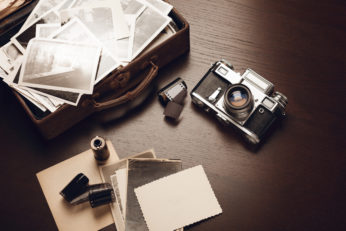 old photos, rolls of film, and a vintage camera