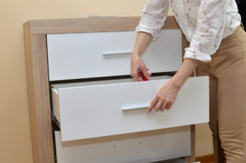 a woman fixing a drawer