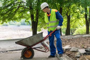 a worker holding a dumper