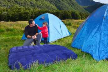father and daughter making a tent