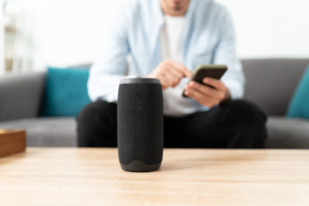 man streaming music on portable amplifier