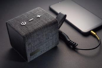 portable amplifier connected to smart phone via aux cable