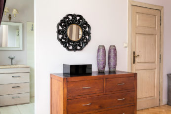 two mirrors in the bedroom