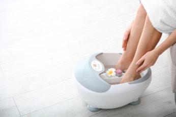 woman rubbing her legs