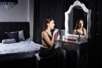 woman using lipstick