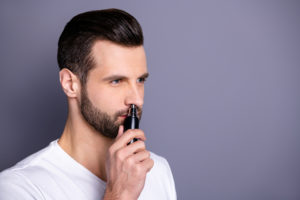 a man cleaning his nostrils