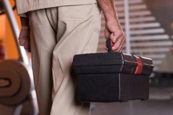 a man holding an equipment storage