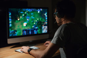 a man playing MOBA game