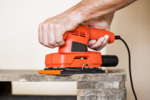 a sanding machine in action