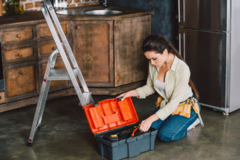 a woman with a toolbox