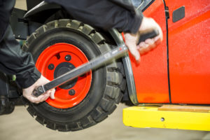 a worker changing a forklift tyre