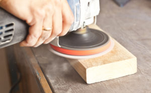an orbital machine sanding a wood