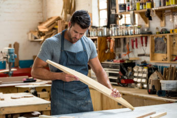 carpenter looking at a piece of wood