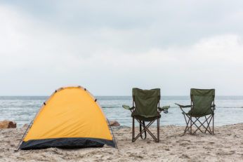 tent and portable seats on seashore