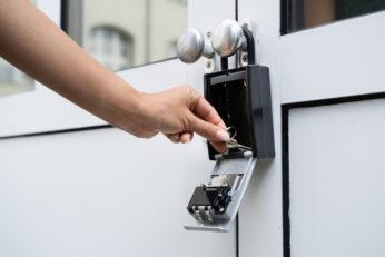 woman using lock box on front door