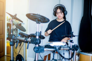 asian girl learning to play the musical instruments