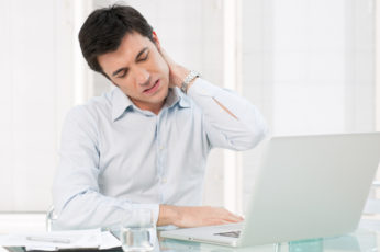 male office worker with neck pain
