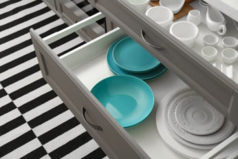 blue and white tableware in drawers