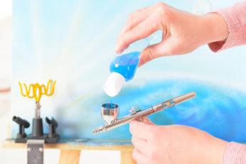 refilling paint inside paint cup