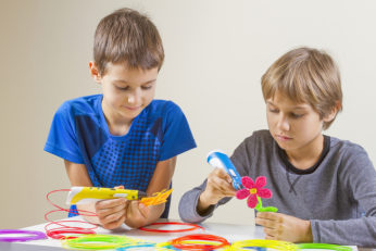 two boys doing arts and crafts