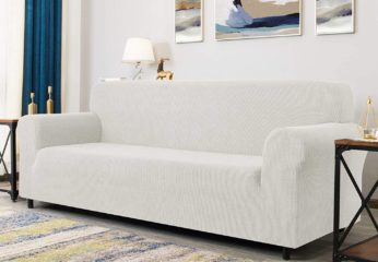 couch with ivory-coloured slipcover