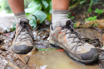 hiker on a water puddle