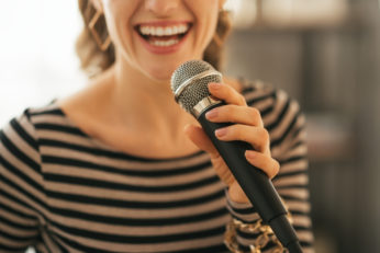 young woman with microphone
