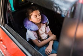 kid sleeping in car