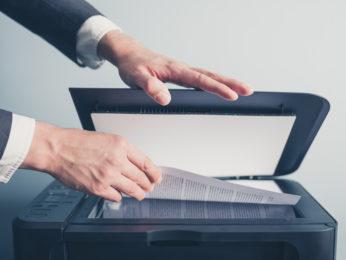 man scanning documents