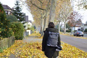 man walking down the street