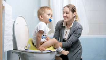 mom toilet training her son
