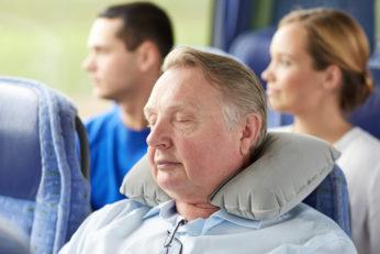 old man sleeping in bus